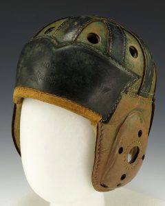 "Hard to believe this leather football helmet was considered ""protection"" back in the day. See page for author [Public domain], via Wikimedia Commons"