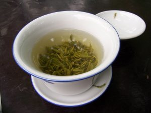 Step away from the coffee. Green tea supplies caffeine too, but also supplies nootropic L-Theanine to help minimize caffeine jitters & nervousness. By McKay Savage from London, UK (China - Chengdu 22 - green tea) [CC BY 2.0], via Wikimedia Commons