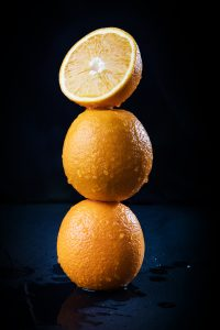 Stack of three juicy oranges
