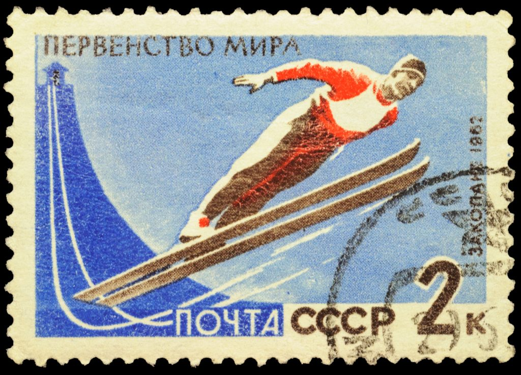 Flying skier on post stamp
