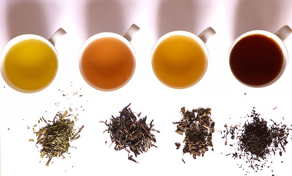 Different types of tea from left to right: green, yellow, oolong, black.